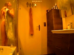 Slim young girl with tiny boobs takes a shower on hidden cam