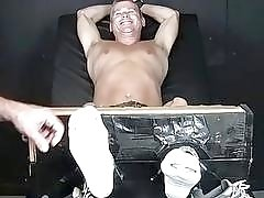 Tied up homo receives a tickling torment from his master
