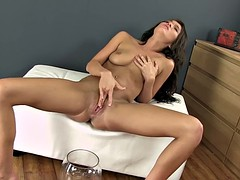 Horny brunette tiffany fox uses a anal butt plug while pissing in her own mouth