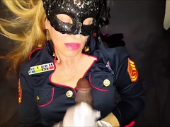 Masked blonde cougar in uniform blows a black cock in POV