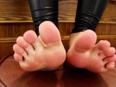 Barefoot shemale wearing latex
