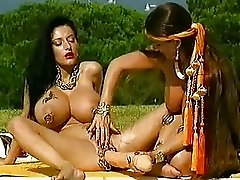 Busty bizarre babe fucks a gigantic dildo outdoors