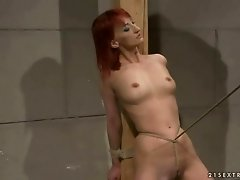 Hot redhead gets bondaged and fucked