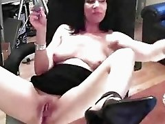 Good looking mature lady pleasures her wet pussy
