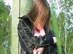 Busty teen dildoing pussy in the grass