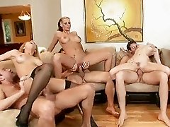 Three girls and three guys having wild group sex in living room