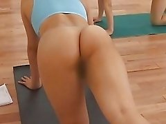 Lovely Asian girls are stretching in gym